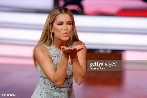 Host Sylvie Meis sends a kiss on stage during the 1st show of the tenth season of the television competition 'Let's Dance' on March 17 2017 in...