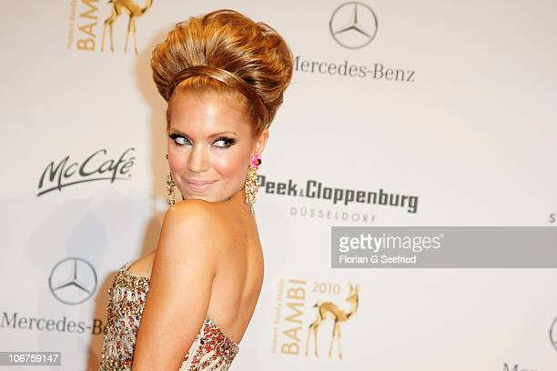 Host Sylvie van der Vaart poses on the red carpet for the Bambi 2010 Award at Filmpark Babelsberg on November 11 2010 in Potsdam Germany