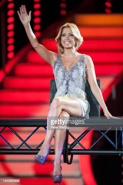 Host Sylvie van der Vaart waves at the audience during 'Let's Dance' 9th Show on May 09 2012 in Cologne Germany