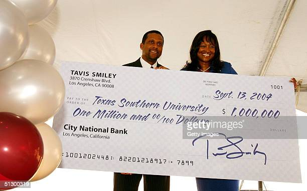 NPR host Tavis Smiley poses with a $1000 donation check to Texas Southern University with TSU president Priscilla Slade at a press conference for the...