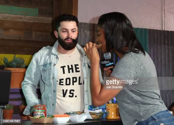 Host Taylor Rooks samples the creation of Baker Mayfield in Nacho FaceOff against Barry Sanders at The Tostitos Cantina at Super Bowl LIVE in Atlanta...