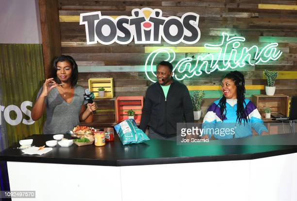 Host Taylor Rooks samples the creation of Barry Sanders in Nacho FaceOff against Baker Mayfield at The Tostitos Cantina at Super Bowl LIVE in Atlanta...