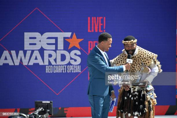 Host Terrence J presents the International Viewer's Choice award for Best New Act to Sjava onstage at Live Red Ready PreShow sponsored by Nissan at...