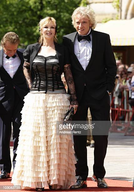 TV host Thomas Gottschalk and his wife Thea Gottschalk arrive at the 'Festspielhaus' ahead of the opening performance of 'Lohengrin' at the Richard...