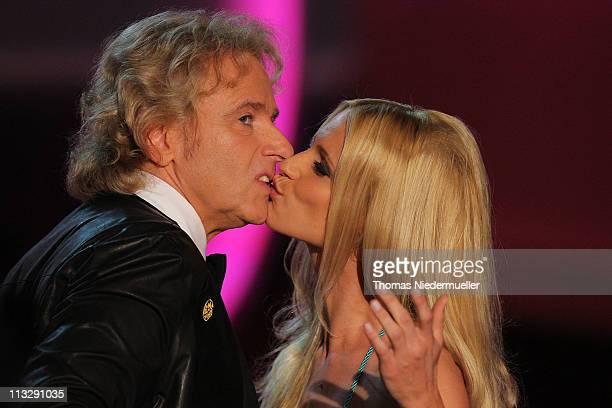 TV host Thomas Gottschalk kisses TV host Michelle Hunziker at the 'Wetten Dass ' TV show on April 30 2011 at the BadenArena in Offenburg Germany