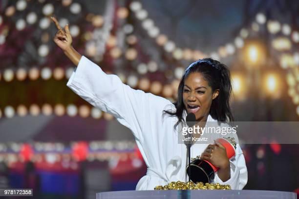 Host Tiffany Haddish accepts award onstage at the 2018 MTV Movie And TV Awards at Barker Hangar on June 16 2018 in Santa Monica California