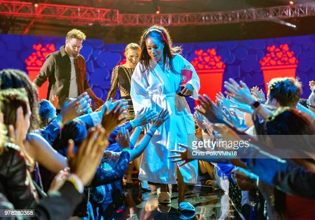 Host Tiffany Haddish accepts the Best Comedic Performance award for 'Girls Trip' onstage from actors Kristen Bell and Seth Rogen during the 2018 MTV...