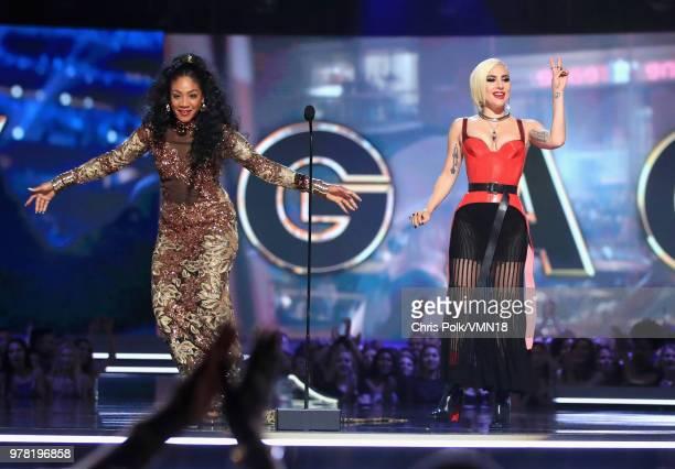 Host Tiffany Haddish and recording artist Lady Gaga speak onstage the 2018 MTV Movie And TV Awards at Barker Hangar on June 16 2018 in Santa Monica...