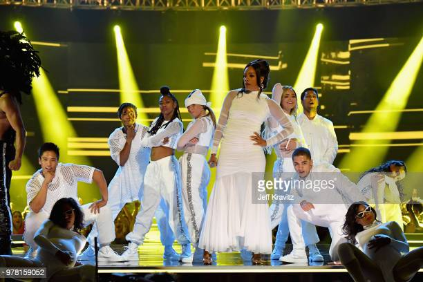 Host Tiffany Haddish performs onstage at the 2018 MTV Movie And TV Awards at Barker Hangar on June 16 2018 in Santa Monica California