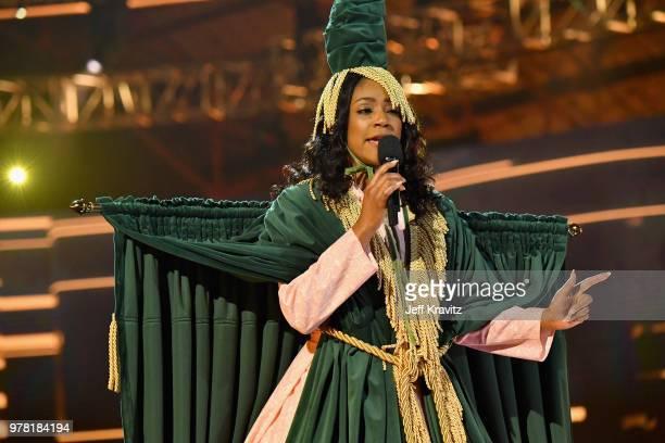 Host Tiffany Haddish speaks onstage at the 2018 MTV Movie And TV Awards at Barker Hangar on June 16 2018 in Santa Monica California