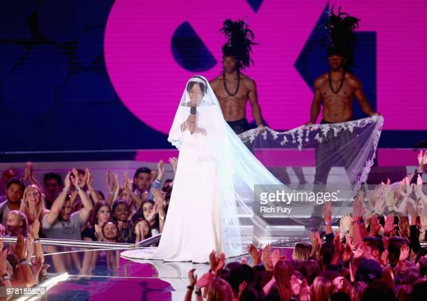 Host Tiffany Haddish speaks onstage during the 2018 MTV Movie And TV Awards at Barker Hangar on June 16 2018 in Santa Monica California