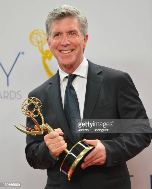 TV host Tom Bergeron poses in the 64th Annual Emmy Awards press room at Nokia Theatre LA Live on September 23 2012 in Los Angeles California
