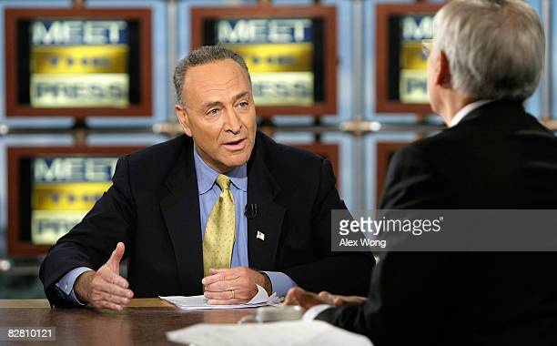 Host Tom Brokaw listens as US Sen Charles Schumer a supporter of Presidential nominee Sen Barack Obama speaks during a taping of 'Meet the Press' at...