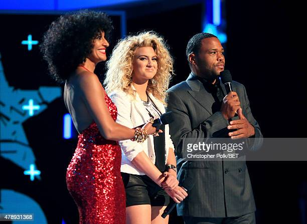 Host Tracee Ellis Ross recording artist Tori Kelly and host Anthony Anderson speak onstage during the 2015 BET Awards at the Microsoft Theater on...