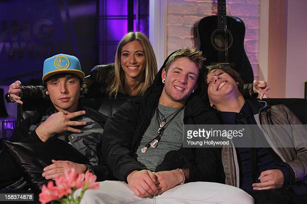 Host Tracy Behr visits with Wesley Stromberg Drew Chadwick and Keaton Stromberg of the band Emblem3 at the Young Hollywood Studio on December 14 2012...