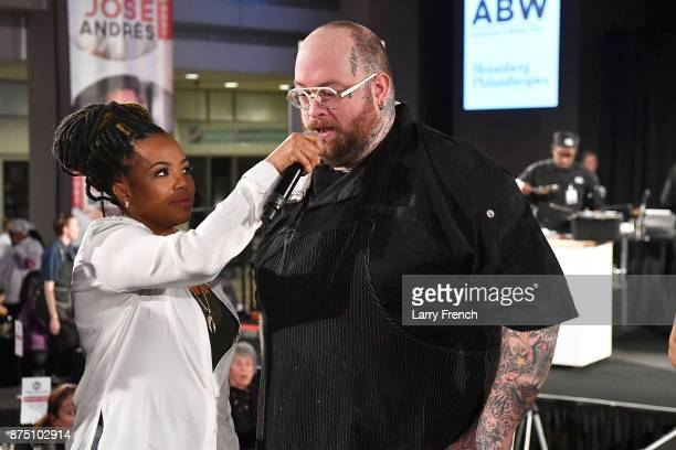 Host Tregaye Fraser interviews Chef Hamilton Johnson of Honeysuckle onstage at DC Central Kitchen's Capital Food Fight on November 16 2017 at the...