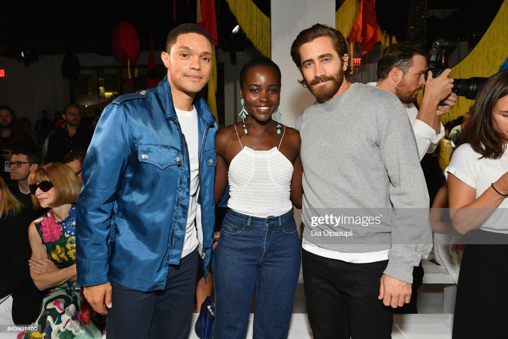 TV Host Trevor Noah and actors Lupita Nyong'o and Jake Gyllenhaal attend the Calvin Klein Collection fashion show during New York Fashion Week on September 7, 2017 in New York City.