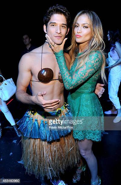 Host Tyler Posey and actress-singer Jennifer Lopez attend FOX's 2014 Teen Choice Awards at The Shrine Auditorium on August 10, 2014 in Los Angeles,...