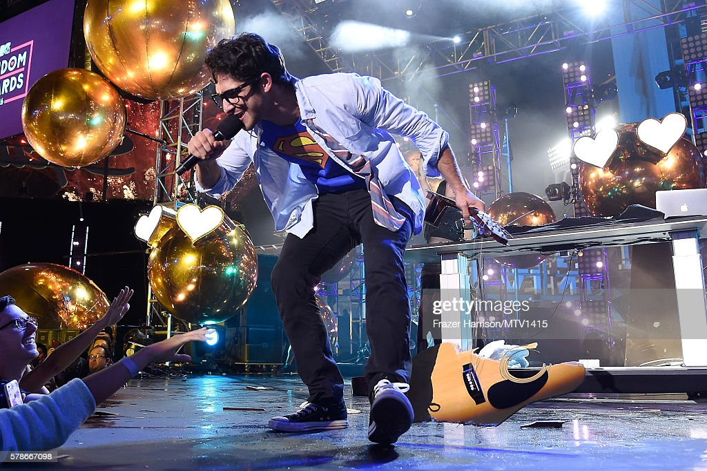 Host Tyler Posey smashes guitar onstage at the MTV Fandom Awards San Diego at PETCO Park on July 21, 2016 in San Diego, California.