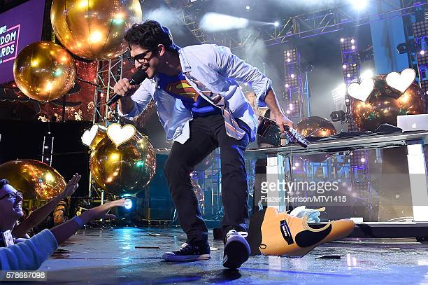 Host Tyler Posey smashes guitar onstage at the MTV Fandom Awards San Diego at PETCO Park on July 21 2016 in San Diego California