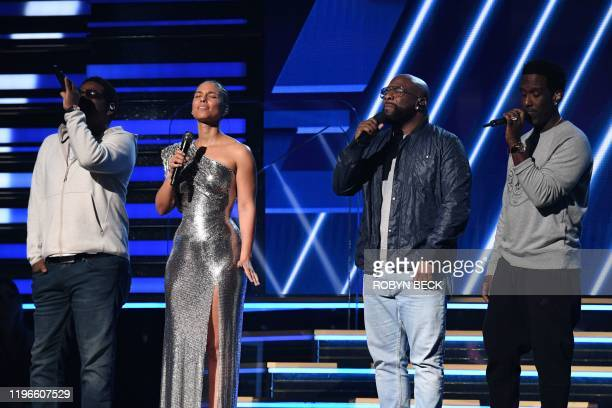 Host US singersongwriter Alicia Keys and Boyz II Men sing in honor of late NBA legend Kobe Bryant during the 62nd Annual Grammy Awards on January 26...