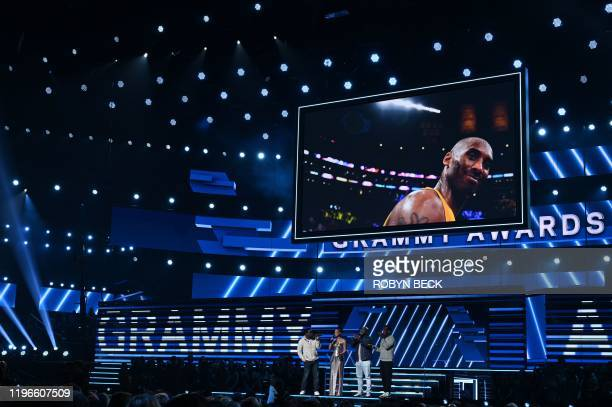 Host US singersongwriter Alicia Keys and Boyz II Men sing in memory of late NBA legend Kobe Bryant during the 62nd Annual Grammy Awards on January 26...