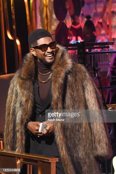 Host Usher speaks onstage at the 2021 iHeartRadio Music Awards at The Dolby Theatre in Los Angeles, California, which was broadcast live on FOX on...