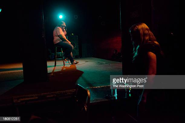 DC Host Valerie Paschall hangs backstage as Jamel Johnson performs during the Identity Crisis Comedy Showcase at the Black Cat nightclub on Friday...