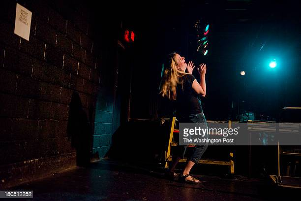DC Host Valerie Paschall laughs backstage during the Identity Crisis Comedy Showcase at the Black Cat nightclub on Friday August 16 2013 in...