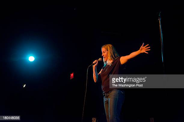 DC Host Valerie Paschall warms up the crowd during the Identity Crisis Comedy Showcase at the Black Cat nightclub on Friday August 16 2013 in...