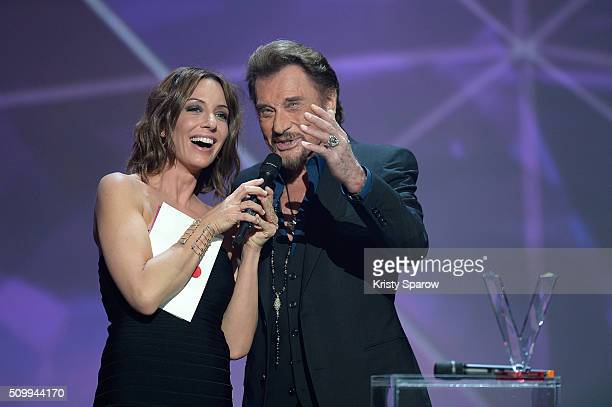 Host Virginie Guilhaume presents Johnny Hallyday with the award for Best Singing Album for 'De l'amour' during the 31st 'Victoires de la Musique'...