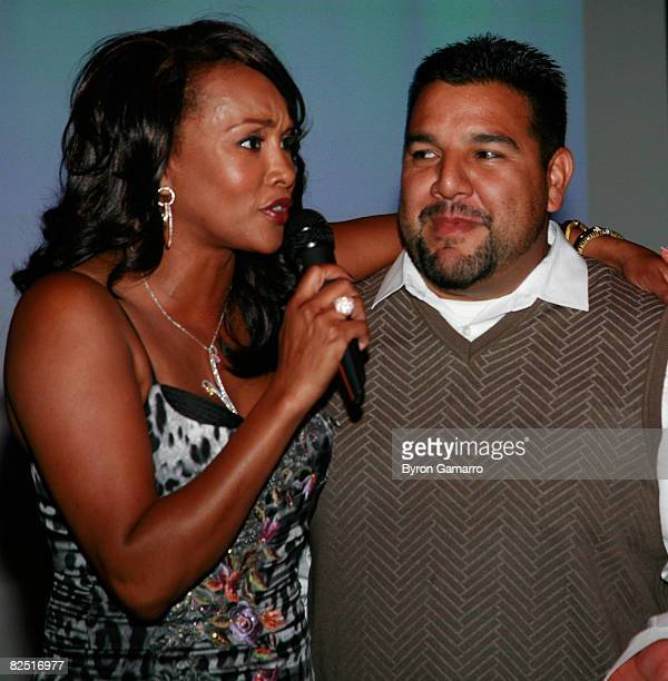 Host Vivica Fox and show creator Chris Abrigo at premiere party for VH1's Glam God television show on August 21 2008 in Encino California