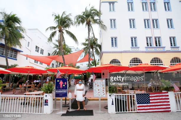 A host waits for patrons at the Oceans Ten restaurant on Ocean Drive on July 04 2020 in the South Beach neighborhood of Miami Beach Florida In order...