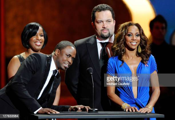 Host Wayne Brady Chairman of the NAACP National Board of Directors Roslyn M Brock NAACP president Benjamin Todd Jealous and host Holly Robinson...