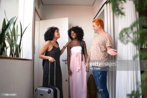 host welcome guests at house accommodation - hostel stock pictures, royalty-free photos & images
