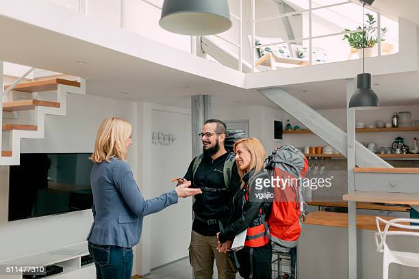 Host welcomes Backpackers In Her Apartment.