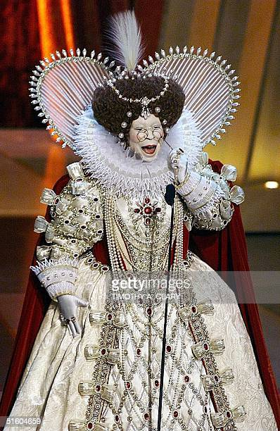 Host Whoopi Goldberg dressed as Great Britain's Queen Elizabeth I opens the 71st Academy Awards 21 March 1999 at the Dorothy Chandler Pavilion AFP...