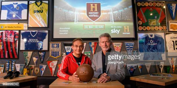 Host Wigald Boning and football legend Paul Breitner attend the preview screening of the new documentaries 'Deutschland Deine Fussballseele' and...