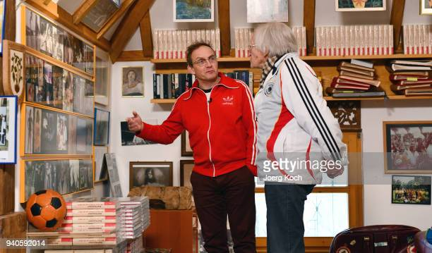 Host Wigald Boning and legendary football coach Rudolf 'Rudi' Gutendorf are seen on set at Gutendorf's house during the shooting for the new...