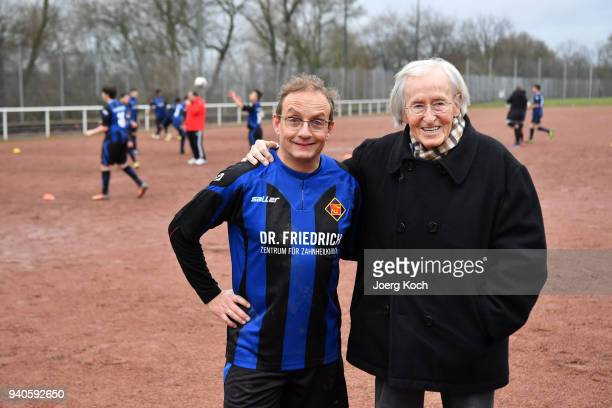 Host Wigald Boning and legendary football coach Rudolf 'Rudi' Gutendorf are seen on set at 'TuS International Koblenz' during the shooting for the...