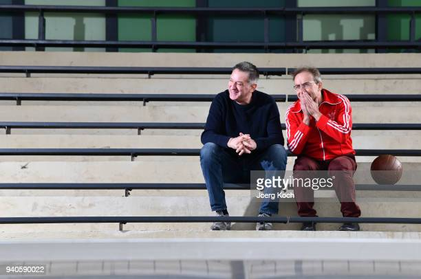 Host Wigald Boning and legendary goalkeeper Eike Immel are seen on set at TSV Eintracht Stadtallendorf football club during the shooting for the new...