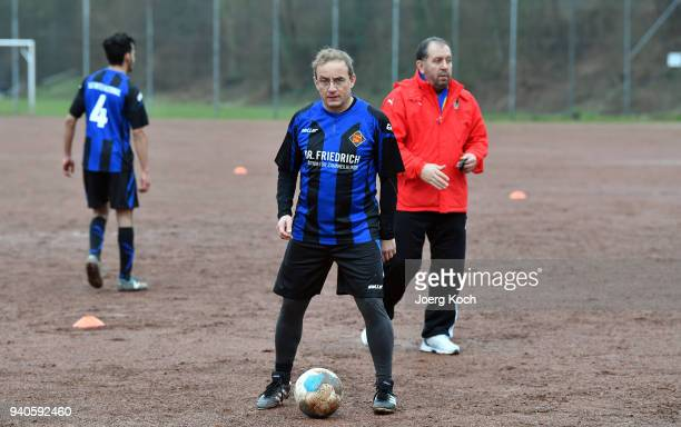 Host Wigald Boning and Syrian coach Jamal Zaghnoon are seen on set at 'TuS International Koblenz' during the shooting for the new documentary...