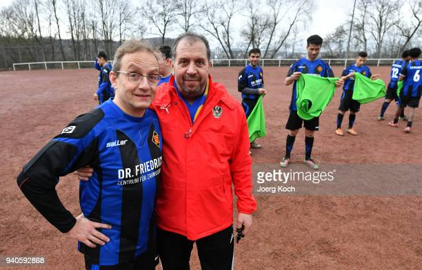 Host Wigald Boning and Syrian coach Zaghnoon Jamal are seen on set at 'TuS International Koblenz' during the shooting for the new documentary...