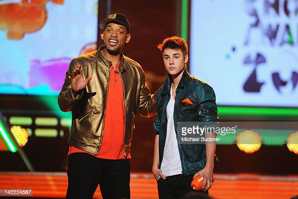 Host Will Smith and singer Justin Bieber speak onstage at Nickelodeon's 25th Annual Kids' Choice Awards held at Galen Center on March 31 2012 in Los...