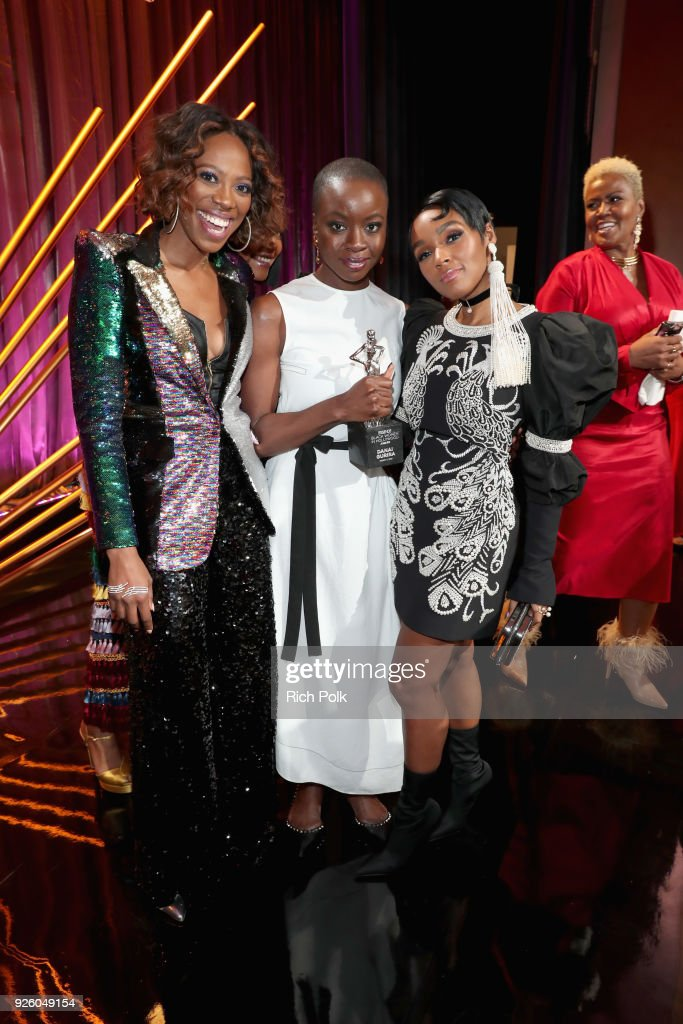 Host Yvonne Orji, Honoree Danai Gurira, and Presenter Janelle Monae pose onstage during the 2018 Essence Black Women In Hollywood Oscars Luncheon at Regent Beverly Wilshire Hotel on March 1, 2018 in Beverly Hills, California.
