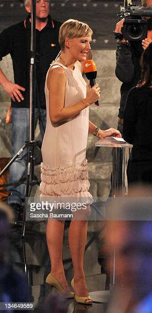 Host Yvonne Ransbach talks during a preshow at the 199th Wetten dass show at the Rothaus Hall on December 3 2011 in Friedrichshafen Germany After 24...