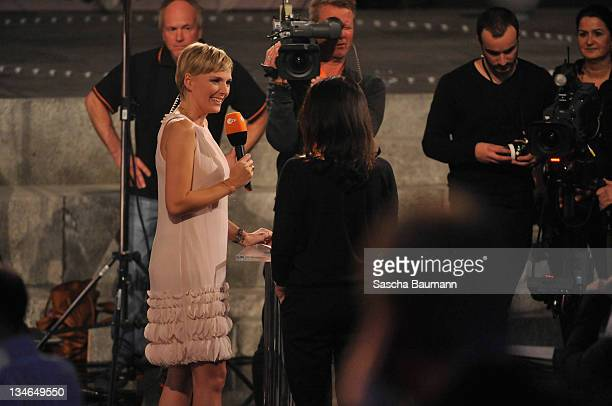 Host Yvonne Ransbach talks to actress Iris Berben during a preshow at the 199th Wetten dass show at the Rothaus Hall on December 3 2011 in...
