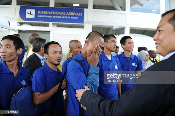 Hostage of Somali pirates react as they arrive at the Jomo Kenyatta International Airport in Nairobi on October 23 2016 after being freed with other...