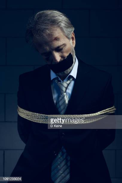 hostage - mafia stock pictures, royalty-free photos & images