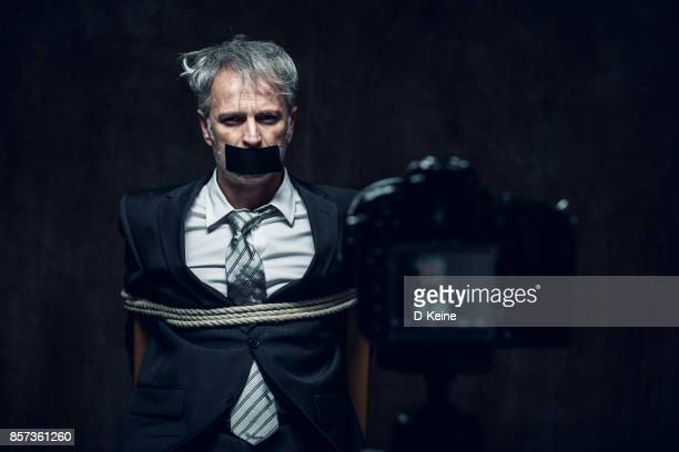 hostage - torture stock pictures, royalty-free photos & images